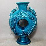 清代孔雀蓝双龙堆塑镂空瓶