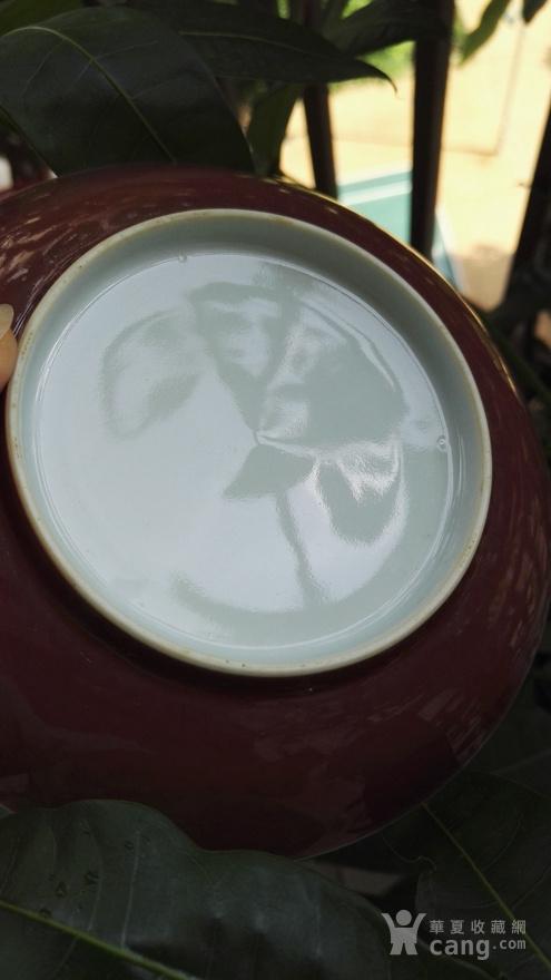 清乾隆祭红釉盘 。